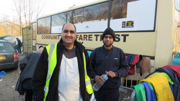 Ghafoor Hussain and crew outside the Community Welfare Trust bus